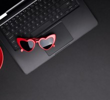 flat-lay-top-view-monochrome-composition-with-laptop-cup-of-coffee-and-sunglasses